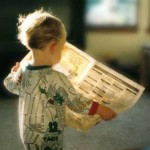 child-reading-newspaper